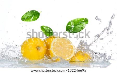 Lemon with water splash isolated on white - stock photo