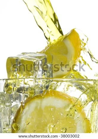 Lemonade and ice. Splashing drink - stock photo