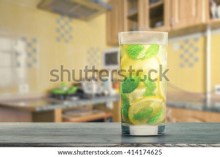 Lemonade on the kitchen table - stock photo