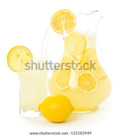 Lemonade Pitcher and Glass with Lemons - stock photo