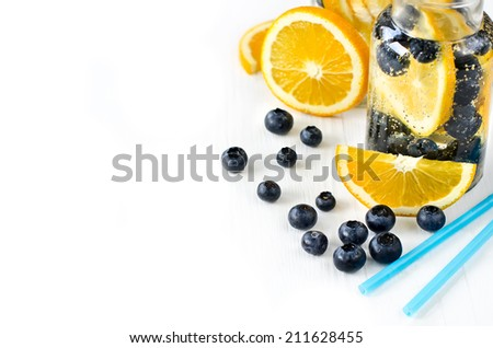Lemonade with fruits, copy space background,  - stock photo