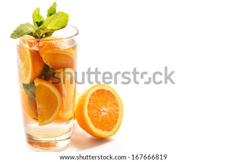 lemonade with mint and tangerines in a glass on a white background - stock photo