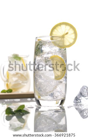 lemonade with mint leaves and lemon on white background - stock photo