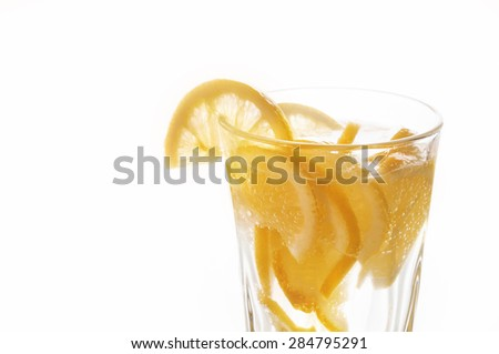 Lemonade with sliced lemon on white background