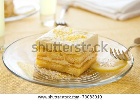 Lemoncello syrup soaked lady fingers layered with light lemon custard - stock photo