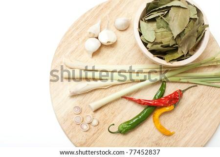 lemongrass, garlic, laurel leaf and pepper on cutting board - stock photo
