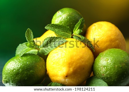 Lemons and limes on bright background - stock photo