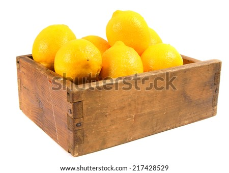 Lemons in an old box on a white background.