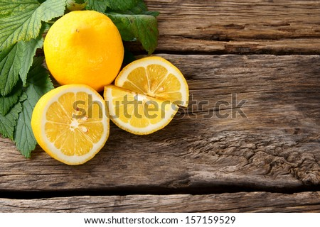 Lemons. On a wooden board. - stock photo