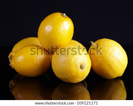 Lemons on black background. - stock photo