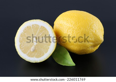 Lemons on black background - stock photo