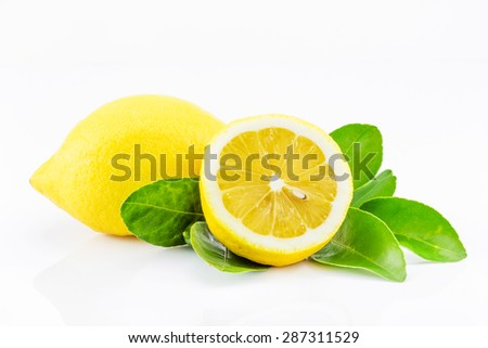 Lemons with leaves on a white background. - stock photo