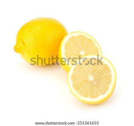 Lemons with slices isolated on white background - stock photo