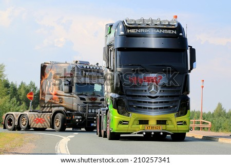 LEMPAALA, FINLAND - AUGUST 7, 2014: Mercedes Benz Actros show truck Joker arrives at Lempaala as part of the truck convoy to Power Truck Show 2014 in Alaharma, Finland.