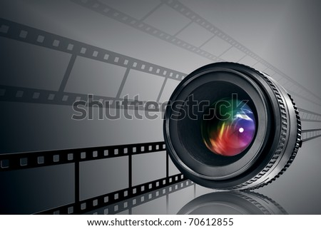 lens and film strip on black background - stock photo