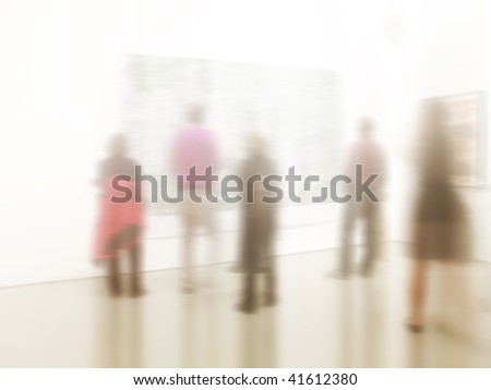 Lens and motion blurred people at an art gallery - abstract and lots of copy-space - stock photo