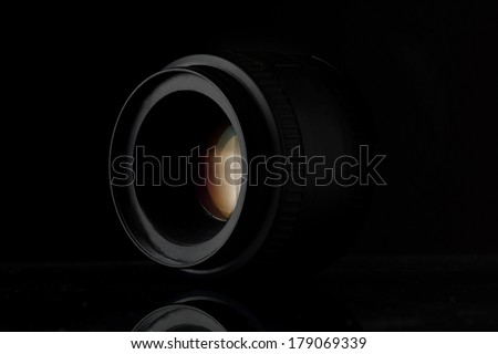 Lens camera low key - stock photo