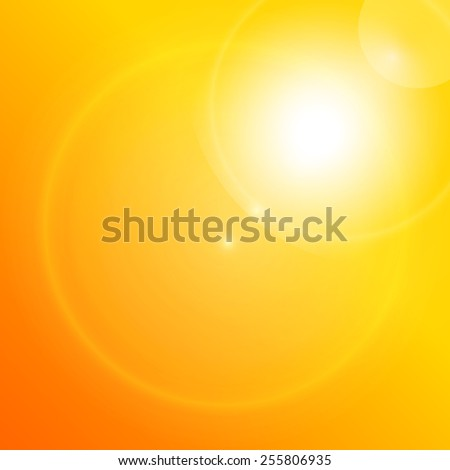 Lens flare on a bright orange background