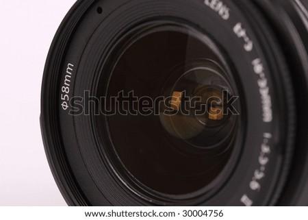 Lens for digital camera on white background - stock photo