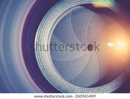 Lens front side exposed aperture blades,Color toned image. - stock photo