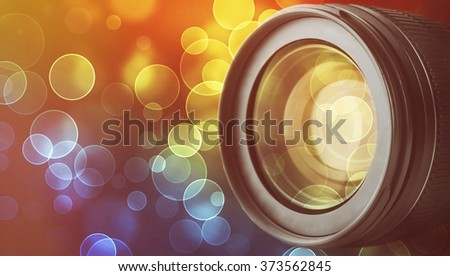 Lens of camera on abstract night background, close up - stock photo