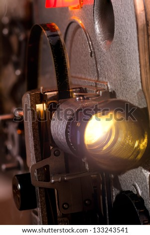 Lens of old  movie projector - stock photo