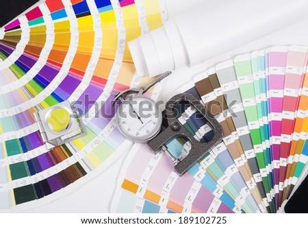 Lens , pantone and micrometer. Design and prepress concept - stock photo