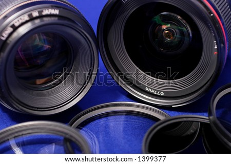 lenses and photo filters on blue background