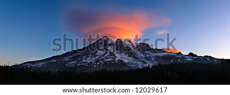 Lenticular Cloud Over Mount Rainier Sunrise - stock photo