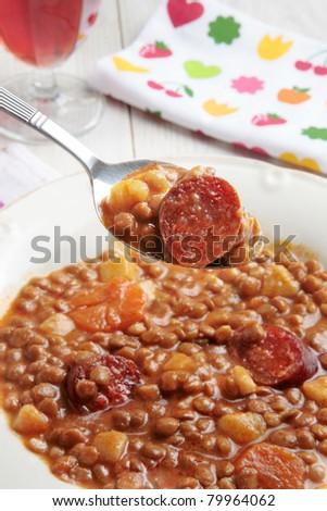 lentil and spanish chorizo soup or casserole - stock photo