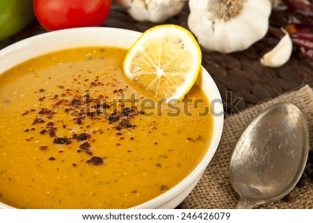 Lentil cream soup with lemon slices  - stock photo