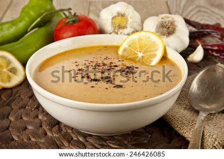 Lentil cream soup with lemon slices  - stock photo