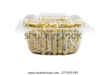 Lentil in a plastic box isolated on white background - stock photo