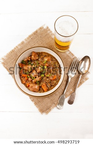 lentil one pot with bacon and glass beer on jute