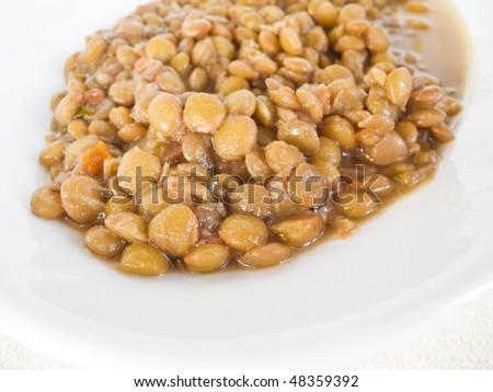 Lentil soup on white dish. - stock photo