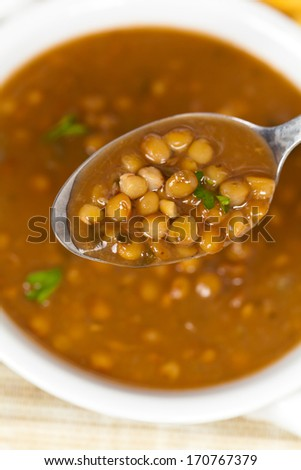 Lentil soup with crackers - stock photo