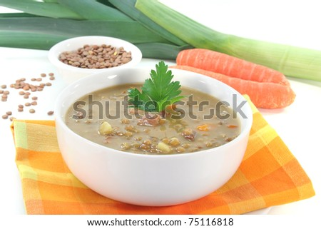 Lentil soup with potatoes, bacon and fresh parsley
