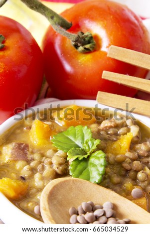 Lentil stew with wooden spoon