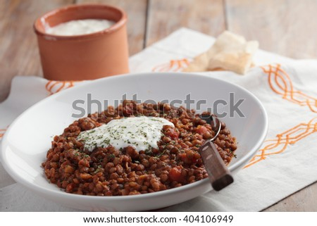 Lentil stew with yogurt and pita bread - stock photo