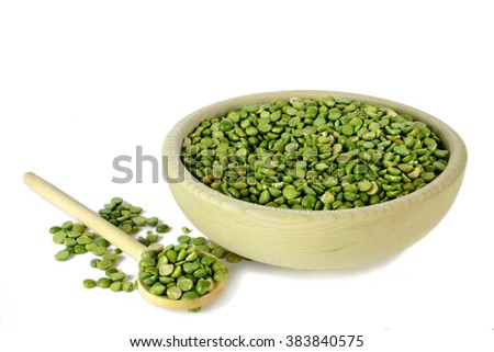 Lentils in wooden bowl and wooden spoon isolated on white background - stock photo