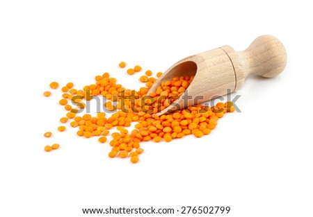 lentils on wooden spoon isolated on a white background - stock photo