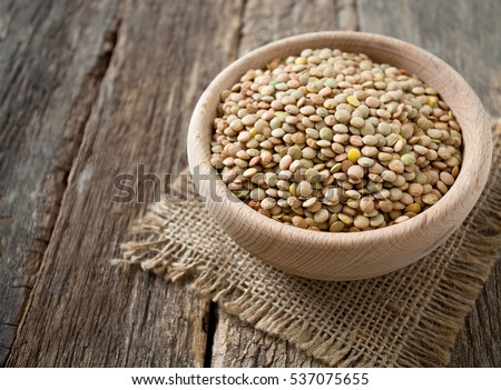lentils on wooden surface