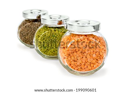 Lentils red, green, brown in glass jars isolated on white background - stock photo