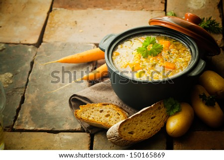 Lentils stew or soup with vegetables on a vintage background - stock photo