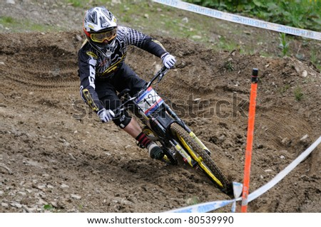 LEOGANG, AUSTRIA - JUN 12: UCI Mountain bike world cup. Marc Beaumont (GBR) at the downhill final race on June 12, 2011 in Leogang, Austria. - stock photo