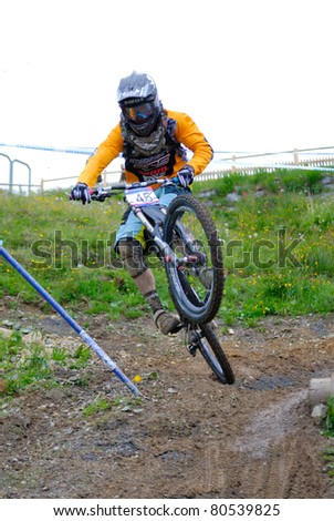 LEOGANG, AUSTRIA - JUN 12: UCI Mountain bike world cup. Mitch Ropelato (USA) at the downhill final race on June 12, 2011 in Leogang, Austria. - stock photo