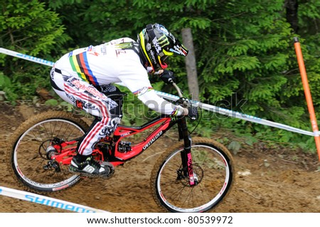 LEOGANG, AUSTRIA - JUN 12: UCI Mountain bike world cup. Participant at the downhill final race on June 12, 2011 in Leogang, Austria. - stock photo