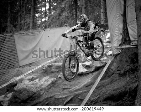 LEOGANG, AUSTRIA - JUNE 13, 2014: Manon Carpenter of Madison Saracen Factory Team is seen during training of the UCI Downhill Mountain Bike World Cup in Leogang, Austria.