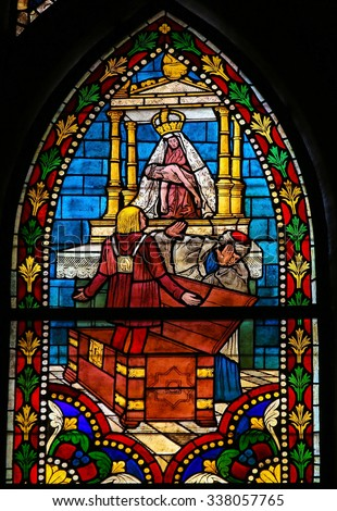 LEON, SPAIN - JULY 17, 2014: Stained glass window depicting a Catholic Saint in the cathedral of Leon, Castille and Leon, Spain. - stock photo