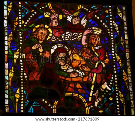 LEON, SPAIN - JULY 17, 2014: Stained glass window depicting a Nativity Scene in the cathedral of Leon, Castille and Leon, Spain.  - stock photo